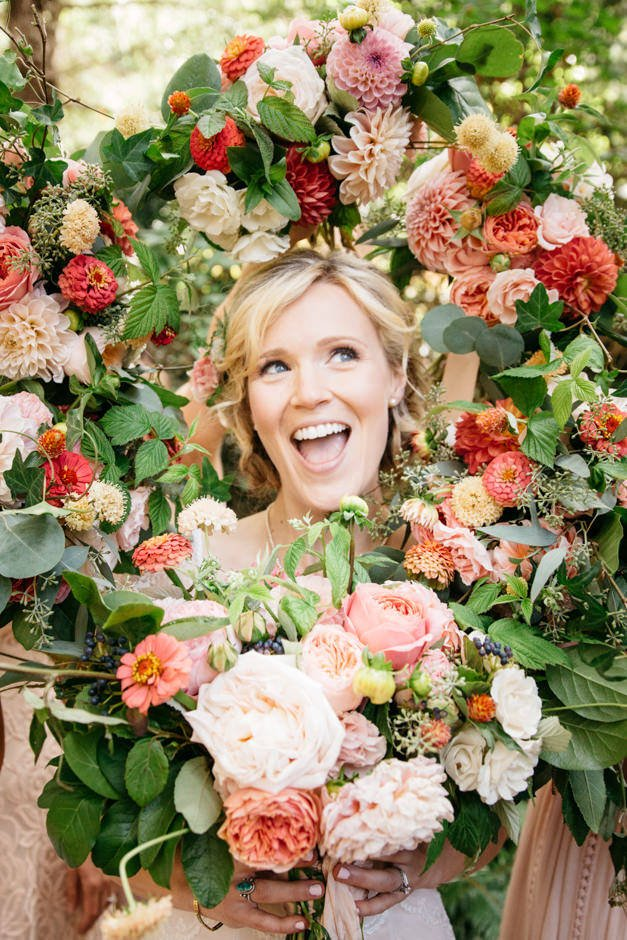 Annemarie Juhlian, South Sound Wedding Officiant and Minister - happy bride in flowers